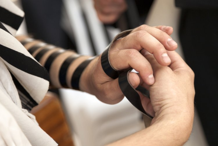 "The actual method for ""laying tefillin,"" as it is called, is intricate and should be reviewed with a rabbi or one."