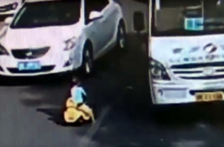 Disturbing Documentation: Toddler Riding a Tricycle in the Middle of a Busy Road