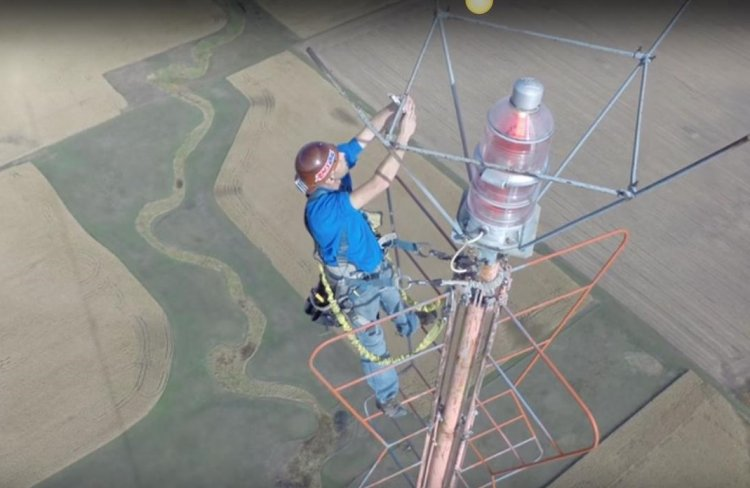 Changing a light bulb 1500 ft. Up in The Air