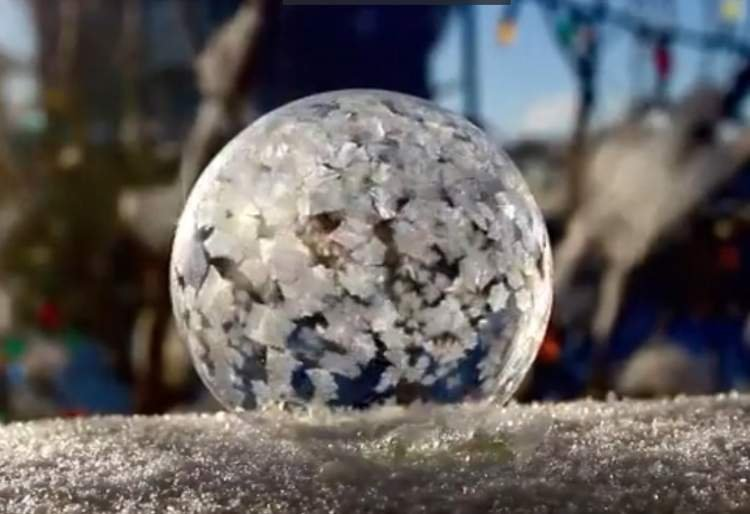 Watch how a Soap Bubble Freezes in Slow Motion