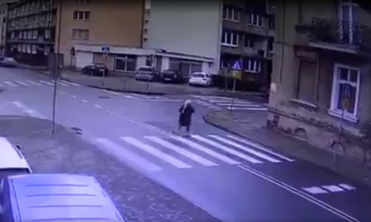 Close Call: Woman Miraculously Avoids Accident - Watch
